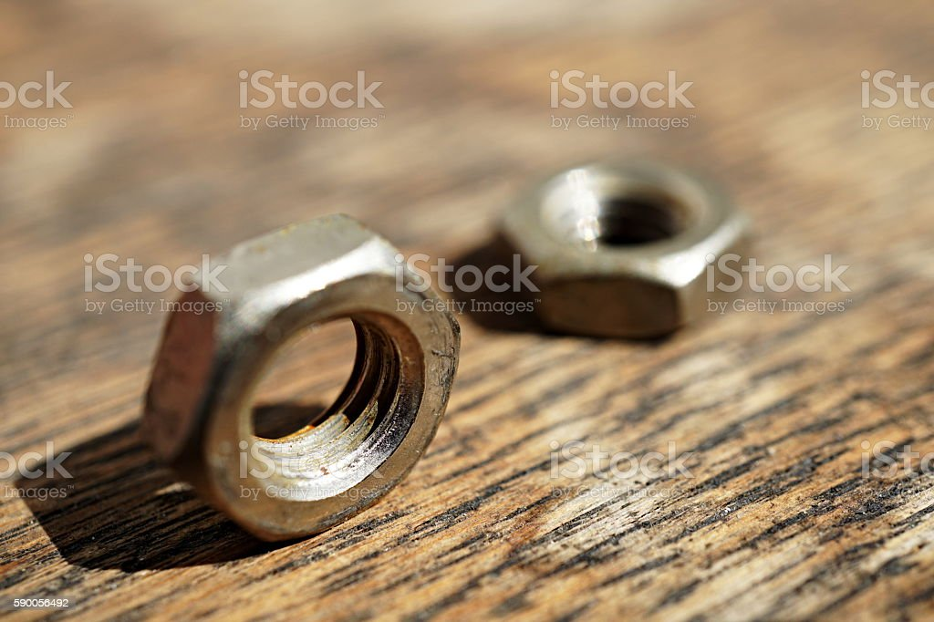 Macro detail of a siver metal small nut (Replacement nut) stock photo