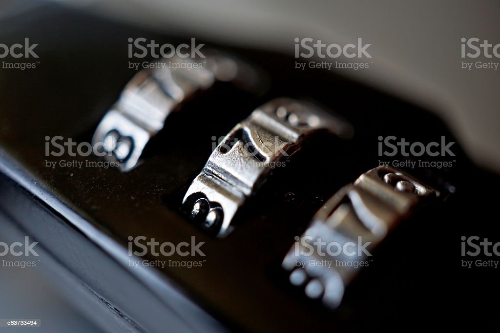 Macro detail of black numerical combination lock with number dial stock photo