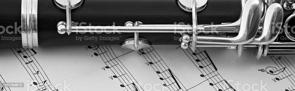 Macro detail of clarinet on sheet music (black & white) royalty-free stock photo