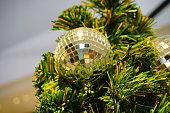 Christmas ball hanging on a fir branch