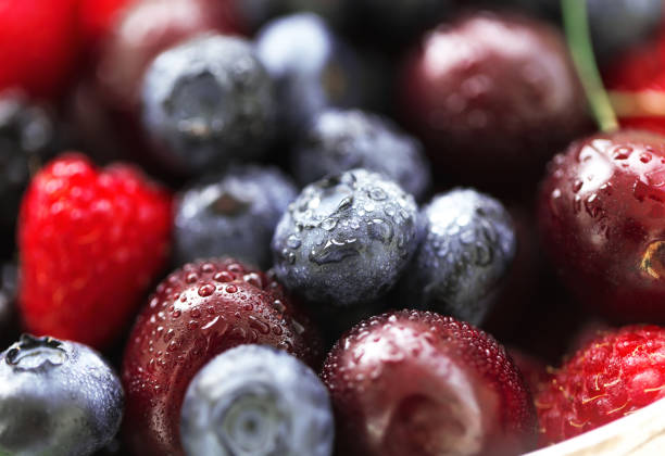macro fresh raw berries. - berry stock photos and pictures