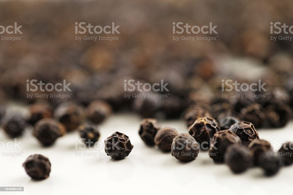 Macro image of black peppercorns stock photo