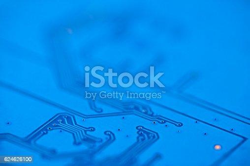 istock Macro image of electronic circuit board (PCB) in blue. 624626100