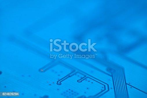 istock Macro image of electronic circuit board (PCB) in blue. 624626294