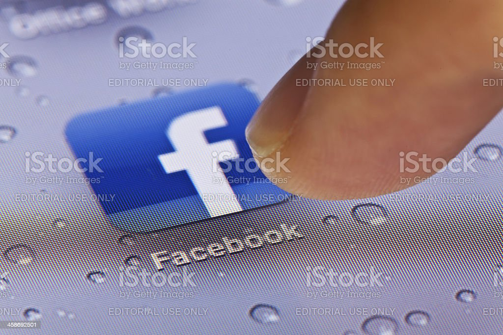 Macro image of running Facebook app on an iPad royalty-free stock photo