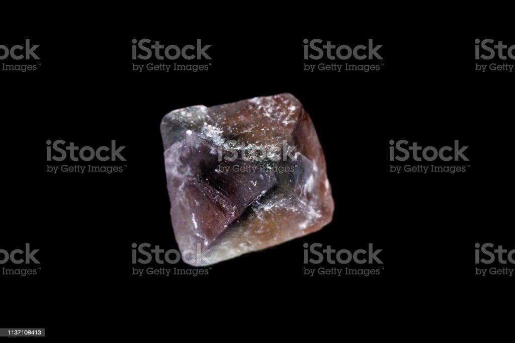 macro mineral fluorite stone on balck background стоковое фото