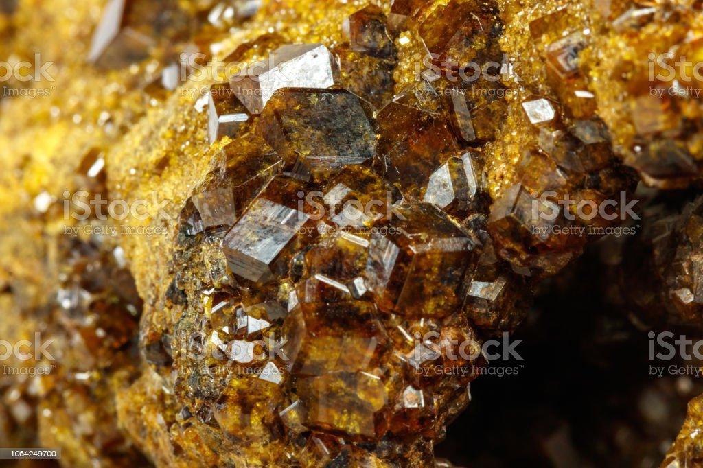 Macro mineral stone Garnet, Green Garnet, Epidote Grossular in the rock on a white background stock photo