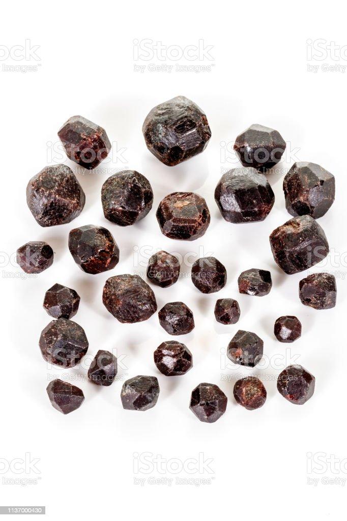 macro mineral stone  Garnet, on a white background stock photo
