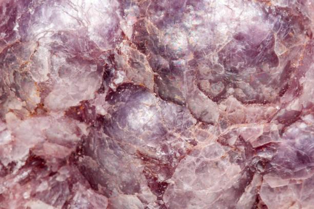macro mineral stone lepidolite in the rock a white background - łupek łyszczykowy zdjęcia i obrazy z banku zdjęć