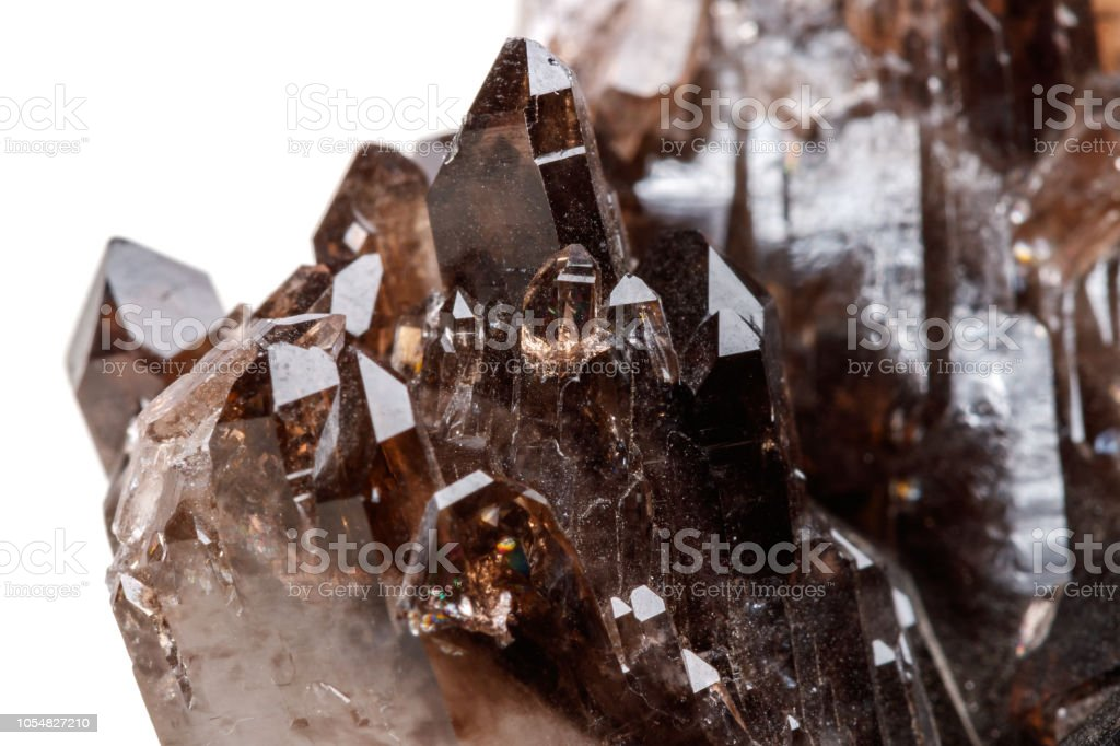 Macro mineral stone Morion crystal in the rock a white background...