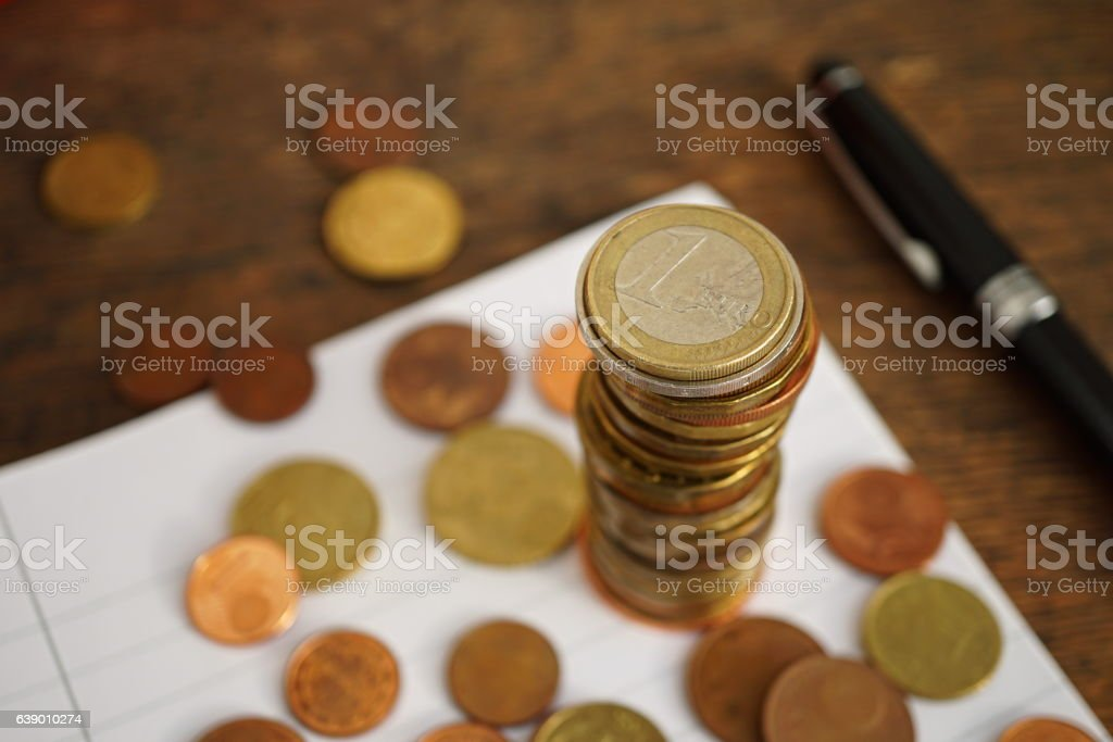 Macro money background made of column of Euro coins stock photo