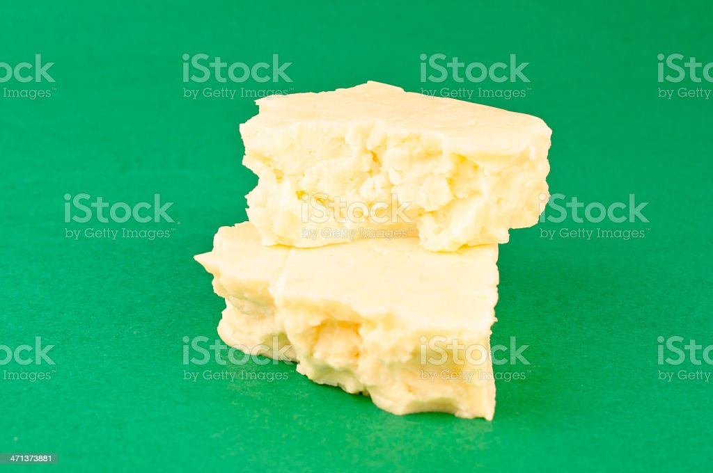 macro monterey jack cheese green background stock photo