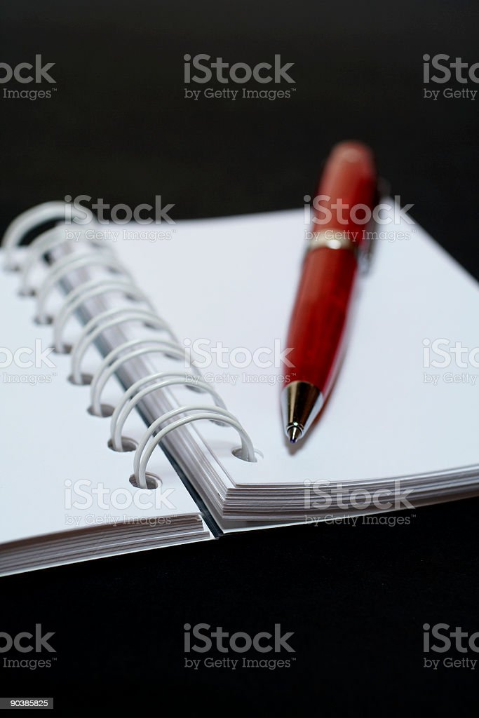 Macro notebook and pen, on black background royalty-free stock photo