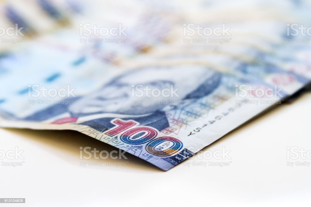 Macro of 100 Peruvian soles bills placed in fan on white background stock photo