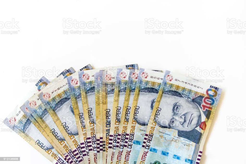 Macro of 100 Peruvian soles bills placed in fan on white background viewed from above stock photo