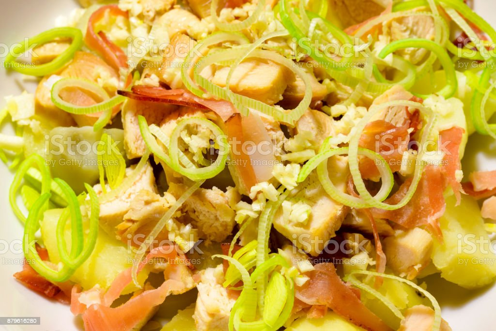 Macro of a chicken salad  in a white porcelain dish stock photo