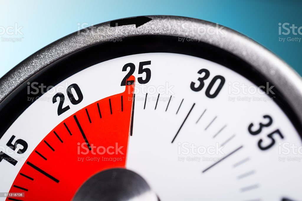 Macro Of A Kitchen Egg Timer - 25 Minutes stock photo