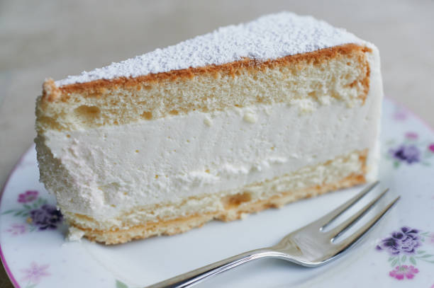 macro of a piece of cream-cheesecake on a plate stock photo