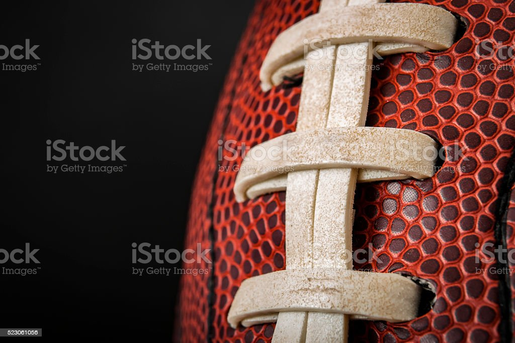 Macro of a vintage worn american football stock photo