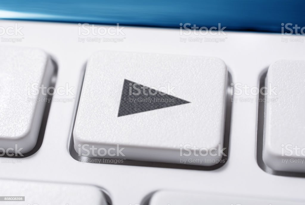 Macro Of A White Play Button Of A White Remote Control For A Hifi Stereo Audio System stock photo