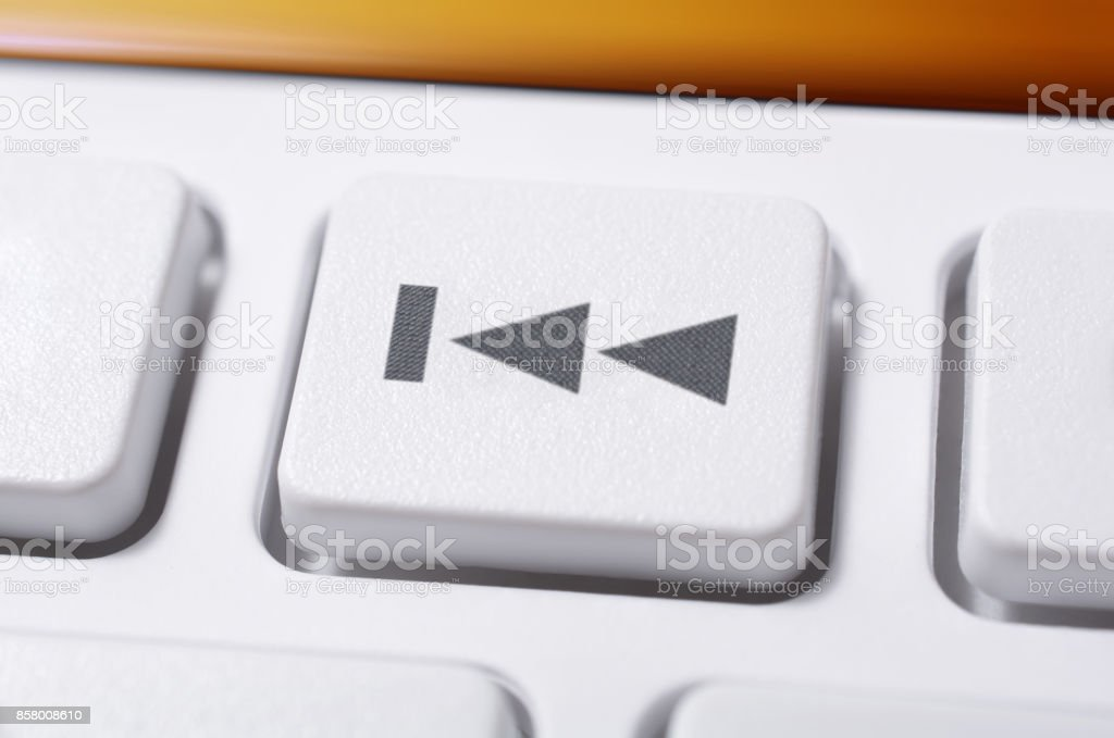 Macro Of A White Skip Backward Button Of A White Remote Control For A Hifi Stereo Audio System stock photo