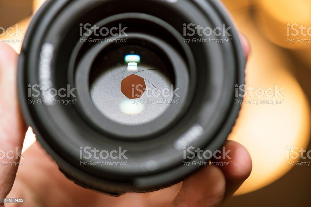 macro of aperture hole in camera lens stock photo