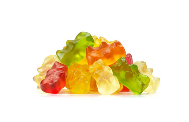 Macro of Assorted Fruit Flavored Gummy Bears or Cannabis Edibles Isolated on White Background stock photo