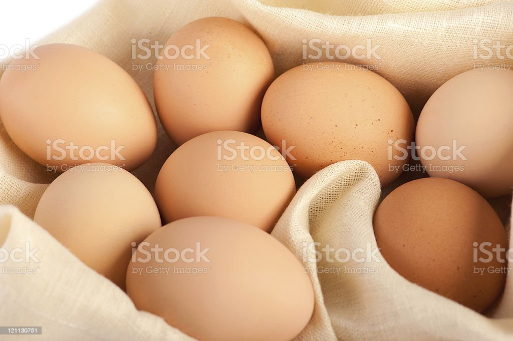 Macro of brown eggs on linen canvas royalty-free stock photo