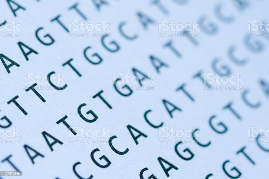 Macro of DNA nucleotide sequence printout on paper stock photo