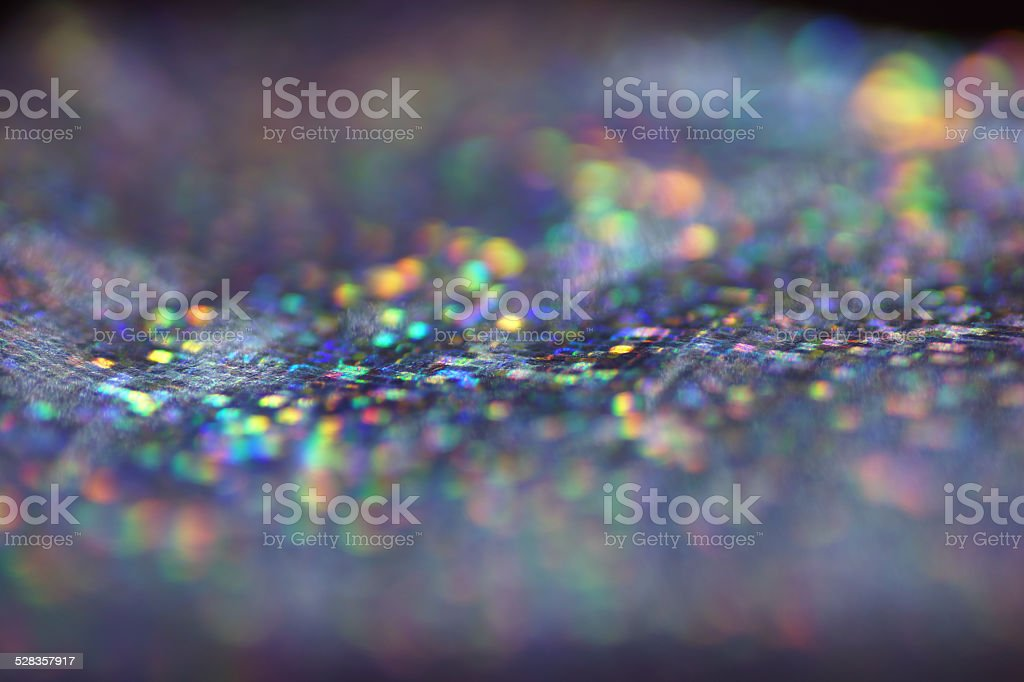 Macro of holographic paper, abstract, bokeh light stock photo