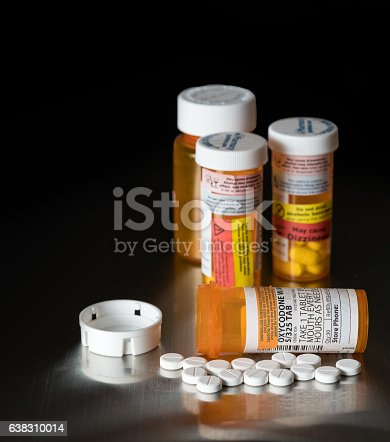 istock Macro of oxycodone opioid tablets 638310014