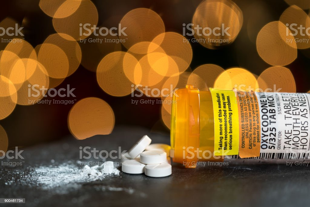 Macro of oxycodone opioid tablets stock photo