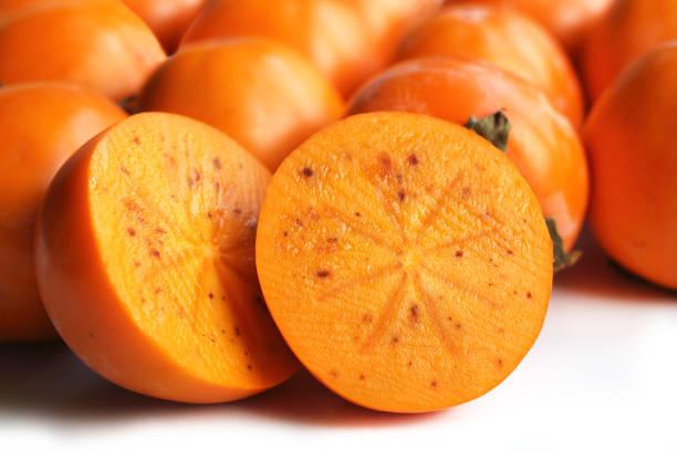 makro von kaki - sharonfrucht stock-fotos und bilder