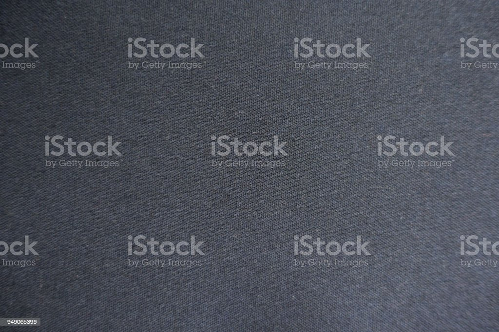 Macro of plain dark grey viscose fabric stock photo