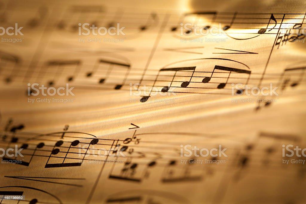 Macro of sheet music in sepia tones stock photo