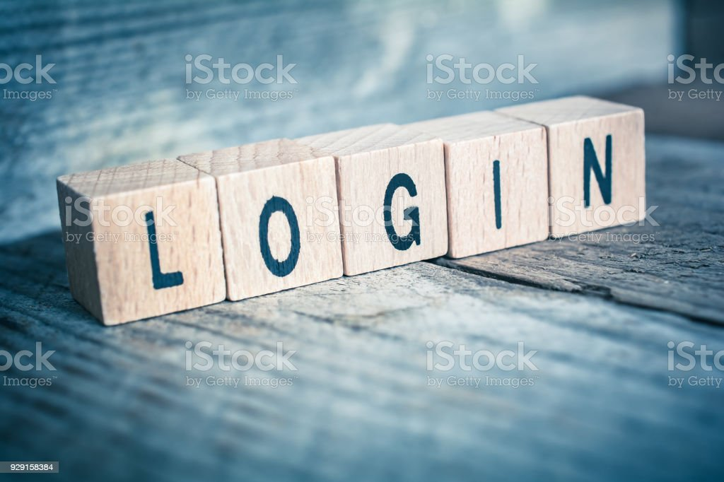 Macro Of The Word Login Formed By Wooden Blocks On A Wooden Floor stock photo