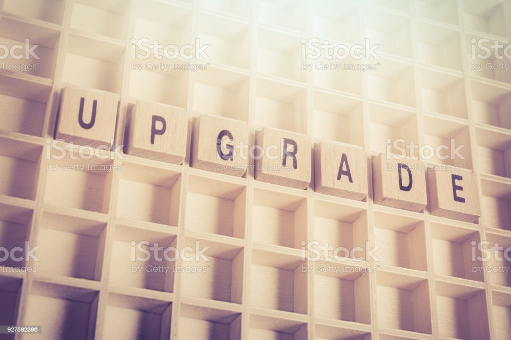 Macro Of The Word Upgrade Formed By Wooden Blocks In A Type Case stock photo