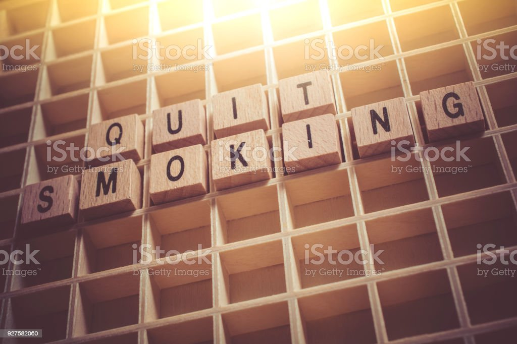 Macro Of The Words Quit Smoking Formed By Wooden Blocks In A Typecase stock photo