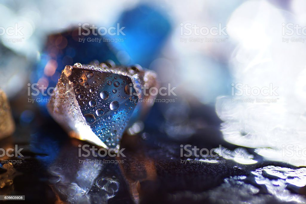 Macro of transparent blue ice cube stock photo