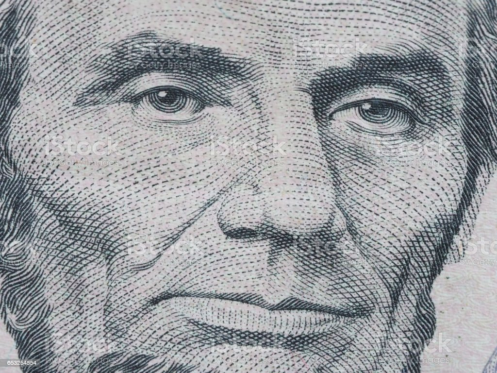 Macro of US dollar series, Abraham Lincoln, a close-up portrait on US five dollars stock photo