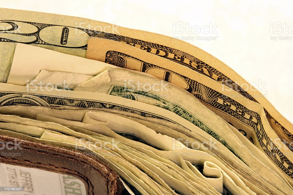 Macro of Wallet bulging with money royalty-free stock photo