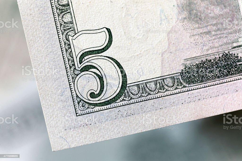 Macro on the corner of 5 USD banknote stock photo