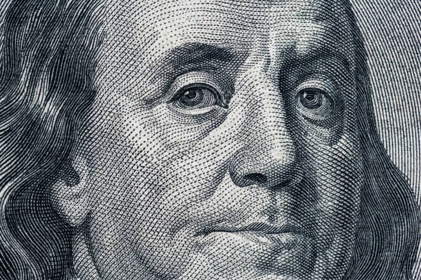 Macro One Hundred Dollar Bills Closeup of a hundred dollar bill of american dollars. Portrait of President Benjamin Franklin money to burn stock pictures, royalty-free photos & images