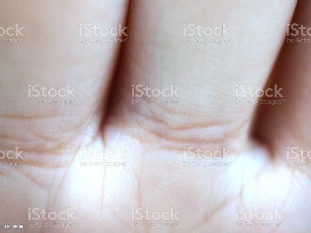 Macro part of forehand palm, finger joint, with line groove stock photo