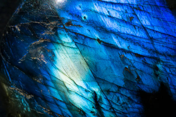 Macro photo of a vibrant cobalt blue crystal moonstone labradorite stone. This is a close up photo of a brilliant and luminous blue fire moonstone.  I used special lighting to bring out the reflective cobalt blue colors and mineral textures. cobalt sulfate stock pictures, royalty-free photos & images