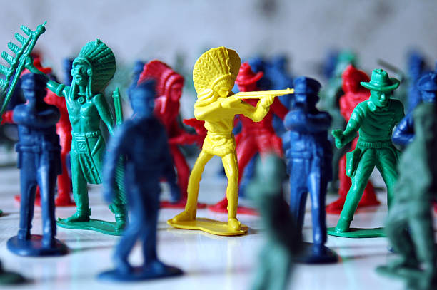 Macro photo of colorful soldiers and American Indian figures stock photo