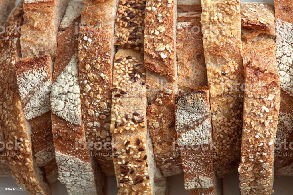 Macro photo of different pieces of fresh bread with flax seeds and sesame seeds. Healthy food. Flat lay royalty-free stock photo