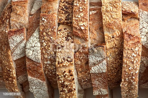 Macro photos of slices of homemade, grain bread with sesame seeds and flax. Organic Healthy Food. Flat lay
