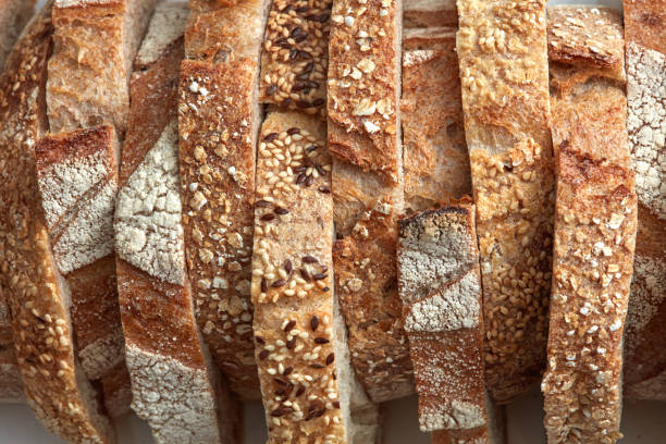 Macro photo of different pieces of fresh bread with flax seeds and sesame seeds. Healthy food. Flat lay stock photo