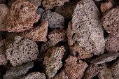 Macro photo of red volcanic lava stones